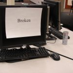 """computer screen with """"broken"""" sign on it"""